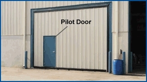 In buildings that are designed without personnel doors using a pilot door is a good alternative. & Pilot-Wicket Doors | Personnel Doors | Doors